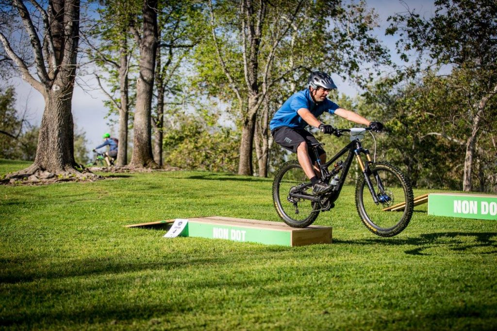 mountain biker jumping off drop box